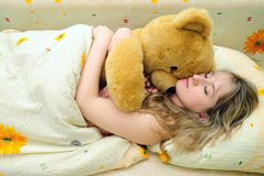 The girl sleeps with a toy bear Royalty Free Stock Photography