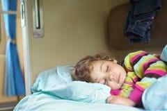 Girl sleeps in train. Little girl sleeps in train Stock Photo