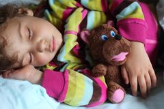 Girl sleeps in train with puppet Royalty Free Stock Photo