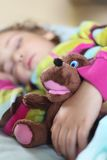 Girl sleeps in train with puppet Royalty Free Stock Photography