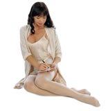 Girl in sleepwear writing letter Royalty Free Stock Photos