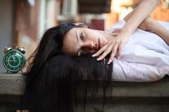 Girl sleepyhead. Sleepyhead girl sleeping on the street on the banisters Stock Photography