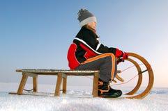 girl on a sleigh Stock Photos