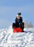Girl on a sleigh. Portrait small girl on a sleigh Royalty Free Stock Image