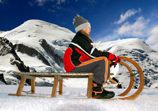 Girl on a sleigh. In Savoy Alps Royalty Free Stock Image