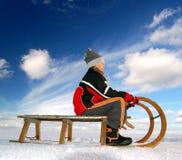 Girl on a sleigh Stock Photography