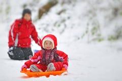 Girl on sleigh Stock Photography