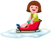 Girl on sleigh Stock Photo