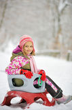 Girl on sleigh Stock Image