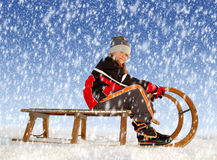 Girl on a sleigh Royalty Free Stock Photos