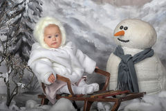 Girl on sleigh Royalty Free Stock Photo