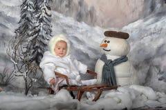 Girl on sleigh Stock Image