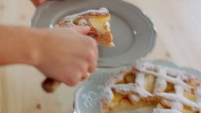 girl slicing freshly baked apple pie with sharp kitchen knife. stock footage