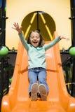 Girl On Slide Stock Images