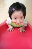 Girl on the slide Stock Photos