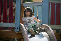 Girl on slide Royalty Free Stock Photos