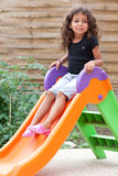 Girl and slide Royalty Free Stock Photography