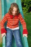 Girl on slide Stock Image