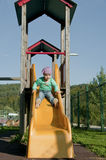 Girl on a slide Royalty Free Stock Photo