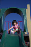 Girl on slide Royalty Free Stock Images
