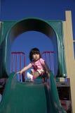 Girl on slide Royalty Free Stock Images