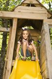 Girl on slide. Royalty Free Stock Image