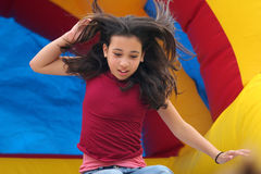 Girl on the slide. Girl on playground Royalty Free Stock Images
