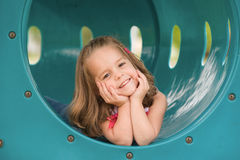 Girl on the Slide. Girl Playing at the Playground stock photos