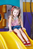 Girl on a slide in kindergarten Royalty Free Stock Photography