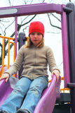 Girl slide playground Stock Image
