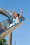 Girl on the slide Stock Photo