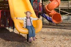 Girl sliding Stock Images