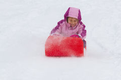 Girl sliding Royalty Free Stock Images