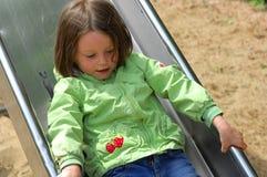 Girl sliding chute. Girl sliding at a chute Royalty Free Stock Photo