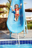 Girl sliding down water slide. Royalty Free Stock Images