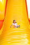 Girl Sliding Stock Photography