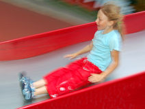 Girl sliding on slide Royalty Free Stock Image