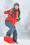 Girl  sliding in the snow Stock Photos