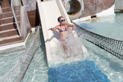 Girl sliding on waterslide Stock Photos
