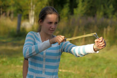 Girl with slingshot Stock Images