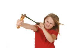Girl with a slingshot on white. Naughty little girl with a slingshot on white stock images