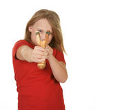 Girl with a slingshot on white. Naughty little girl with a slingshot on white royalty free stock photos