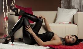 Girl in a slinky black Stock Image