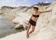 A girl and a slope of white cliff called `Scala dei Turchi` in Sicily Stock Photos