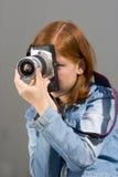 Girl with SLR photo camera. Girl shooting SLR photo camera Royalty Free Stock Images