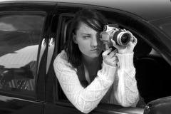 Girl with SLR photo camera. Girl shooting SLR photo camera Royalty Free Stock Photography