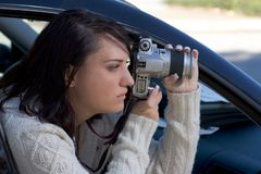 Girl with SLR photo camera Royalty Free Stock Images