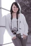 Girl with SLR photo camera. Girl holding SLR photo camera Royalty Free Stock Photo