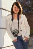 Girl with SLR photo camera. Girl holding SLR photo camera Royalty Free Stock Images