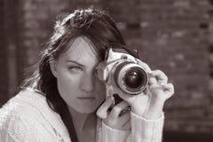 Girl with SLR photo camera. Girl holding SLR photo camera Stock Photos